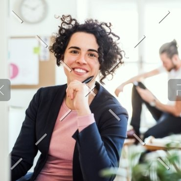 demo-attachment-89-a-portrait-of-young-businesswoman-sitting-in-a-JABCPXQ