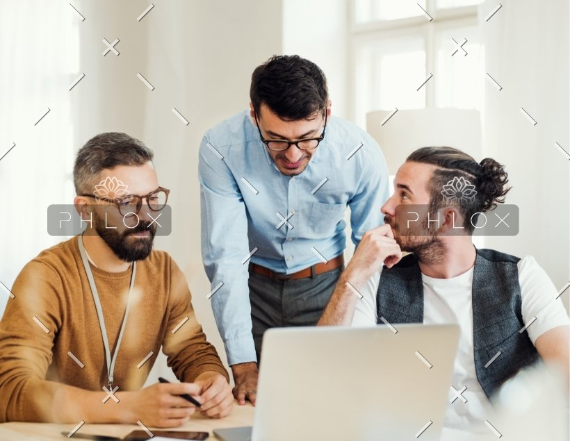 demo-attachment-82-group-of-young-businesspeople-with-laptop-working-8SHTZUN